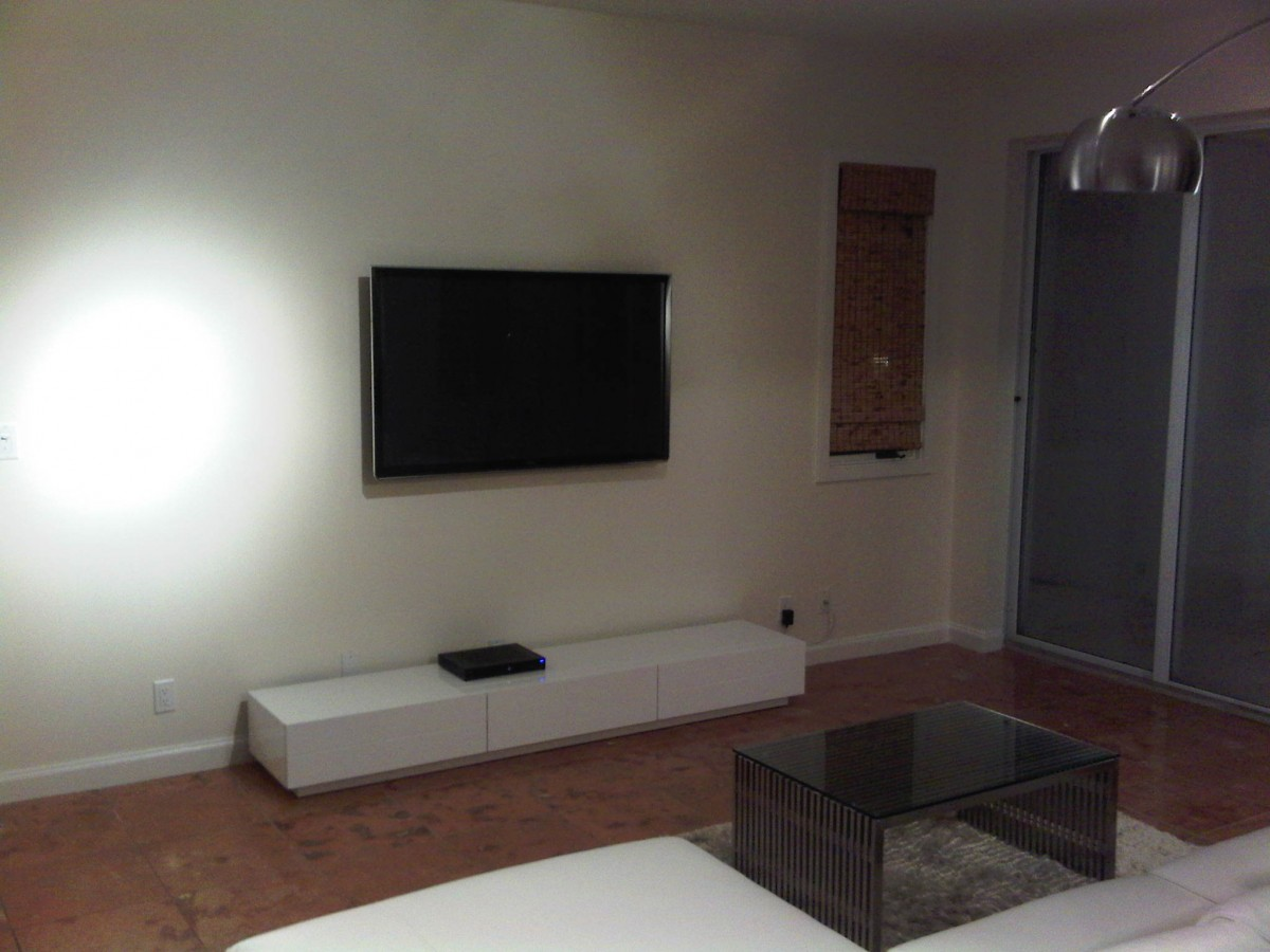 Residential Home Theater Premium Audio Visual installation by dmg Martinez Group in Miami