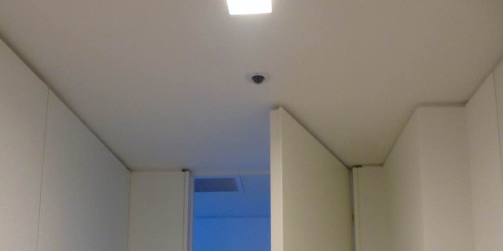 Custom installation of AXIS M3014 Fixed Dome Network Camera with cables hidden through the ceiling, in Miami Beach, FL. By dmg Martinez Group.